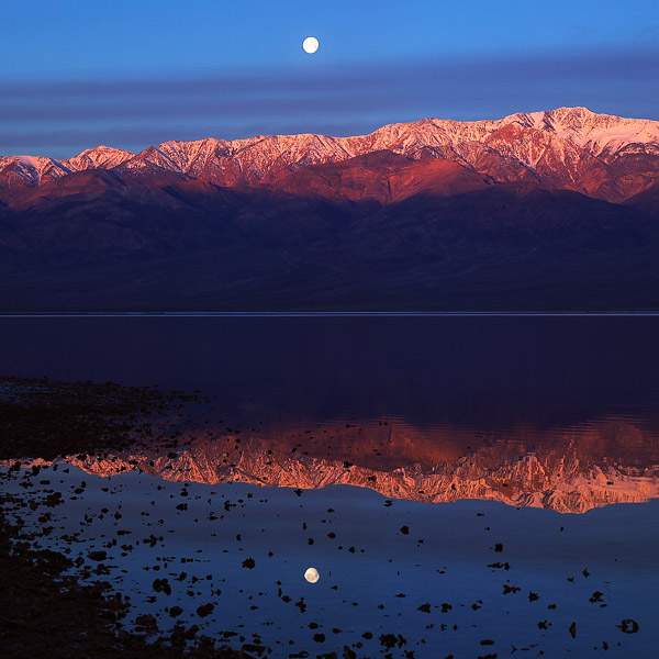 Moonrise, Telegraph Peak and the Panamint Mountains are reflected in what many have called Lake Manly during the unusual winter...