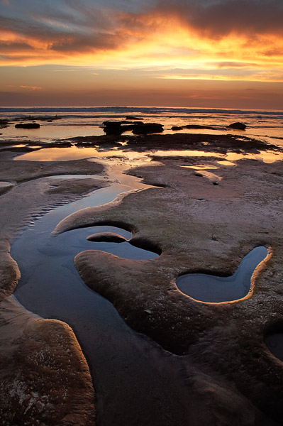 Low tide creates some unique shapes, highlighted by a nice sunset.