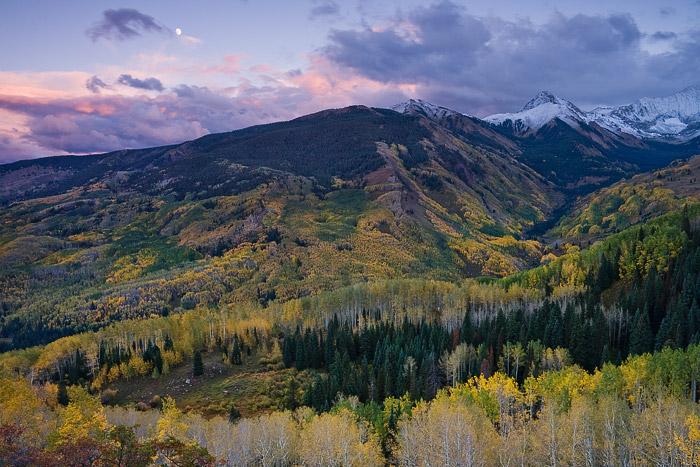 An autumn moon rises over Capitol Creek.