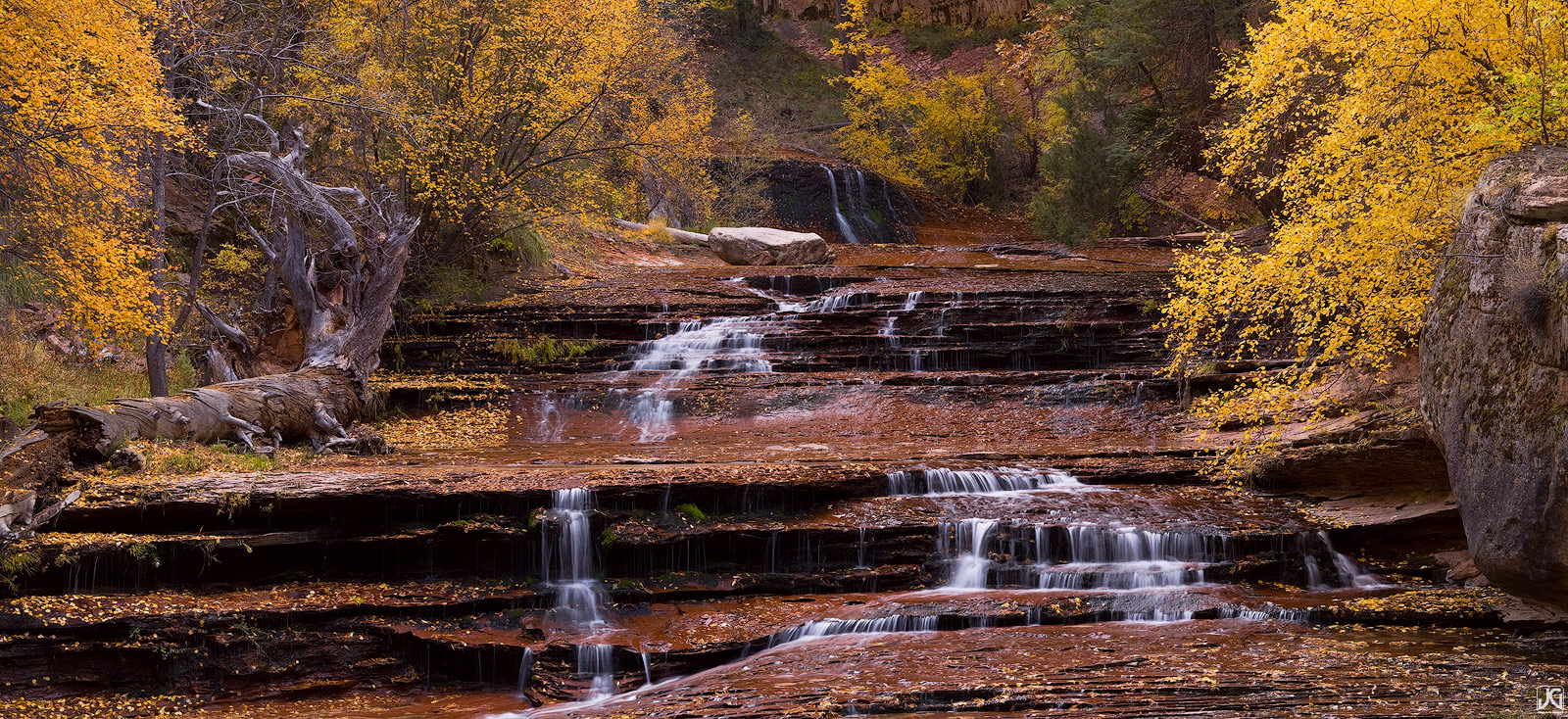 Panoramic view of Archangel Cascades, a series of waterfalls over the sandstone creek bed, along the way to the Subway in Zion...