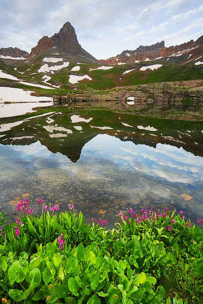 Golden Horn and Pilot Knob stand tall above their reflections in a small tarn in Upper Ice Lake Basin.